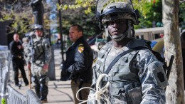 A Maryland Army National Guard Soldier keeps watch in front of City Hall in Baltimore, April 28, to help deter violence in that area. The Maryland National Guard was activated to assist local law enforcement officials with peacekeeping operations in the city during recent protests. (Photo by Staff Sgt. Ron Lee, 29th Mobile Public Affairs Detachment)  (Photo courtesy of the Maryland National Guard)