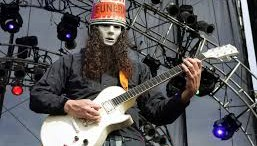 "Modern ""metal"" guitarist, Buckethead, shredding on stage.Buckethead has released over 200 albums and released one album per day in the month of October."