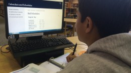 A student works on homework. Pictured on the computer screen are the class times of the block schedule. Photo Credit: Sam Timmons