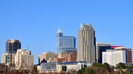 Pictured is the skyline of downtown Raleigh. Multiple sites list Raleigh as a great place to live due to its lively downtown ambiance and continuous job growth.