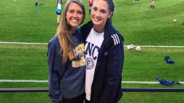 Madison Hoffmann (pictured right) in front of the UNCG soccer stadium. Hoffmann committed to UNCG in December of 2014.