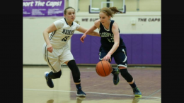 Kelly Funderburk, right, dribbles down the floor. The Pride will begin the state playoffs with a home game on Tuesday at 6:00. Photo Courtesy: High School OT