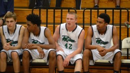 Starters Jonathan Mebane and Patrick Rice along with other teammates sit on the bench during a game this season. The Pride were led by Mebane in their win over Wake Forest in round one Tuesday night.