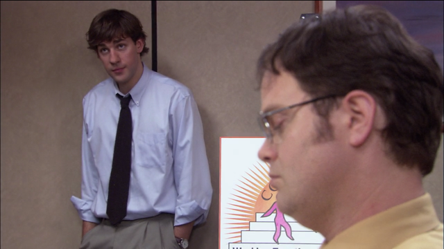 Dwight and Jim in a conflict resolution course, after Dwight complains to the head of HR. Jim continuously pranks Dwight, which adds to the comedic value of the show.