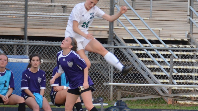 Madison Hoffmann challenges for a header against a Broughton player. The Pride are taking on Sanderson and Wake Forest high school next week. (Photo courtesy: John Robinson)