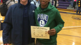 Alex Hunter right, and Coach Russ Frazier, left, pose with Hunter's award. Hunter, a junior, has been the starting point guard for the Pride since his freshman year. Photo Courtesy: Russ Frazier