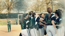 The softball team huddles up against Enloe. The team is working towards the playoffs this season. photo courtesy of Anna Gold