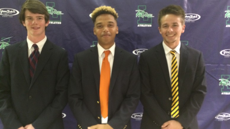 Parker Beebe, Adrian Brown and Eric Fitz pause after signing to get a picture. The boys signed to colleges such as Guilford College, Tusculum College, and Queens University of Charlotte.