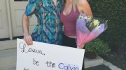 """Ryan Watson, junior, asked Lauren Geikie, junior, to prom with a creative sign and flowers. The sign reads, """"Be the Calvin to my Klein at prom."""""""