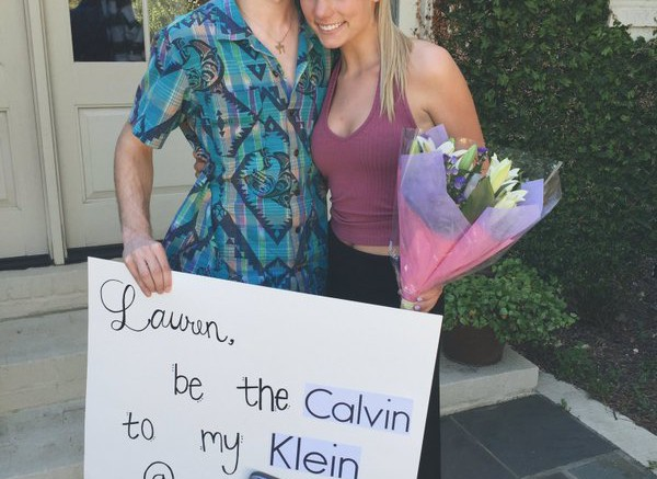 "Ryan Watson, junior, asked Lauren Geikie, junior, to prom with a creative sign and flowers. The sign reads, ""Be the Calvin to my Klein at prom."""