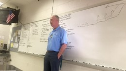 "Dr. Raymond ""Chip"" Stone teaches three AP Environmental Science classes. He structures his classes with a 30-60 minute interactive lecture and ends the class with a study hall for students."