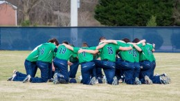 The Pride Baseball team huddles up during a game against Heritage earlier this season. Everyone on the team got to enjoy some action in Columbia this week. Photo courtesy of Harrison Pair.