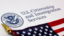 The seal of the US Citizenship and Immigration Service. The USCIS provides naturalization tests to immigrants.