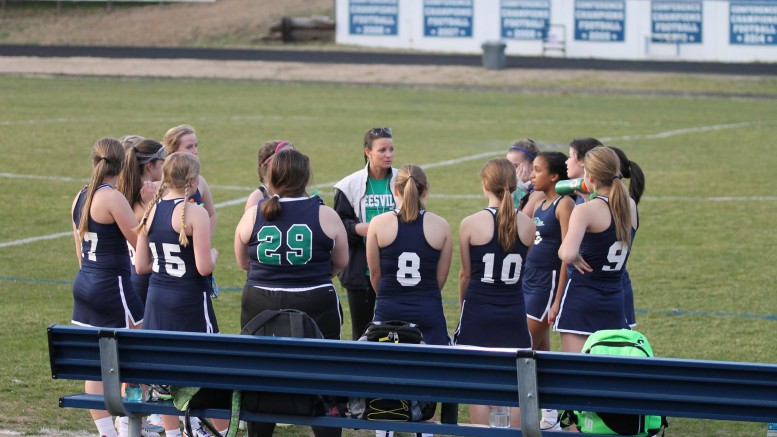 Coach Greenhaw talks to the JV team during halftime at their game against Wake Forest. The girls lost to the Cougars 0-7.