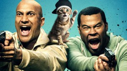 """The poster for Keanu features Key and Peele wielding pistols as Keanu sits on their shoulders. Keanu wears a do-rag and chain and is renamed New Jack after being kidnapped by Cheddar, leader of the """"Blips"""" gang. (Photo courtesy of nerdreactor.com.)"""
