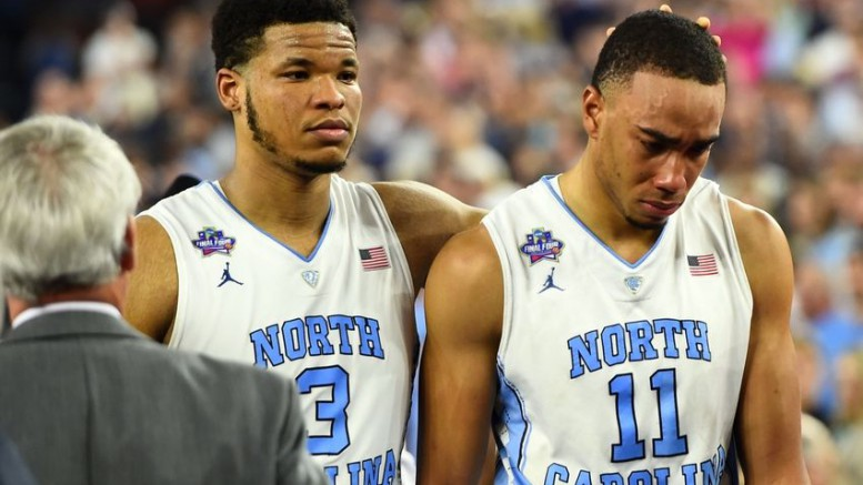 After their loss at the NCAA tournament championship, Kennedy Meeks (left) comforts his teammate Brice Johnson (right). This isn't the only time this year a North or South Carolina team has experienced a loss in the championship game.
