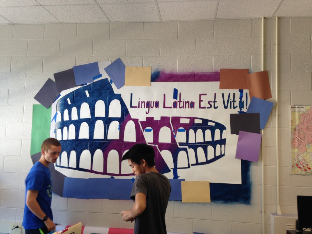 Following the AP exam, what can the AP Latin students do? How about paint symbols of gods and two columns? (Photo Courtesy of Jacob Phillips)