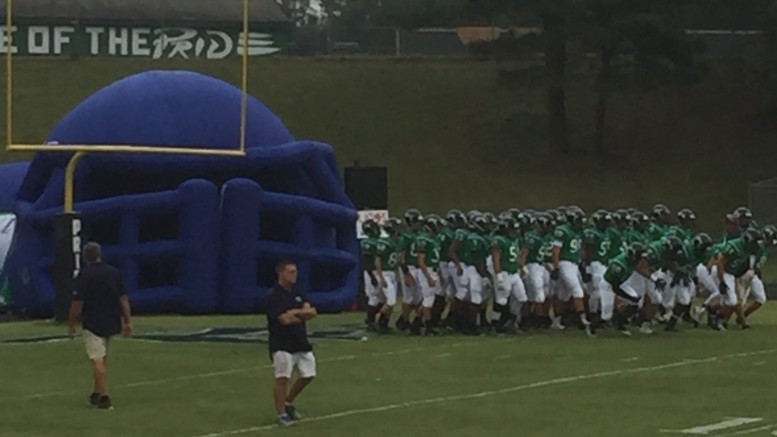 The Pride football team warming up before a very exciting match against J.H. Rose. Leesville fell short 54-48 in triple overtime.