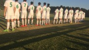 The soccer team lines up and awaits the starting line to be announced. The Pride overcome Rolesville with a score of 7-0.