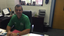 Dr. Muttillo utilizes his time during lunch to sign papers in his office. Muttillo's hard work and dedication toward the school makes him the perfect candidate to receive the award.