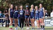 The members of the 2015 LRHS Girls Cross Country team with their NCHSAA 4A Girls Cross Country Championship third place trophy.  Although Leesville lost four of their top seven runners to graduation, they are still considered to be the 12th-best team in the state this season by MileSplit. (Photo courtesy of Audrey Hemming)
