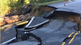 Hurricane Matthew caused widespread damage across Wake County by tearing down trees and power lines and flooding roads. This road, located near Heritage High School, partially collapsed due to water damage. (Photo used with permission of Graham Savage)
