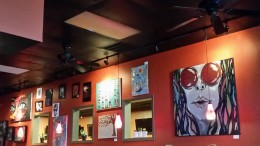 Artwork is hung up all over the walls at Flying Burrito to decorate the restaurant. Among the display are many of Carson Rainey's works of art.