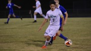 Luca Menozzi, senior, passes a Spartan defender in the second half.The Pride's second win of the season over the Spartans solidify their second place position in the conference rankings.