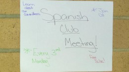 The Spanish club posts sheets advertising their club to the school. The club is welcome to all newcomers.