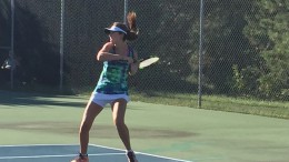 Leesville tennis player Lauren Robbins, sophomore, returns a ball during a match. Robbins is undefeated in singles play this season. (Photo use by permission of Lisa Robbins)
