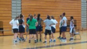 Basketball players listen to Coach Daniels during tryouts.They wait for him to give the agenda for practice on first day of tryouts. (Photo courtesy of Kyla Stone-Houze)