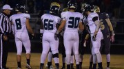 The Pride's captains (left to right) Cooper Eason-Riddle, Matt Melvin, Danny Blakeman, and Matt Hamilton, lineup for an official's meeting prior to the start of the game. This would be the final game for Leesville's Football seniors. (Photo used be permission of Emma Sheppard)