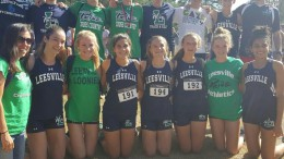 The men's and women's varsity cross country team run at the regional meet. After running a strong race, the men's team placed fourth and the women's team placed third.