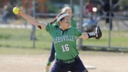 Becca Jones throwing heat in a LRHS Varsity Softball game last year. Taken soon after her recovery, the path to her success was long, painful, but worthwhile. (Photo by permission of Becca Jones and the News and Observer)