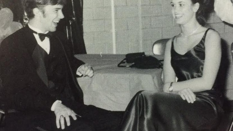 Kathryn Chiles, junior, laughs with her date Scott Guirlinger, a senior from Enloe at Leesville Winterfest in 1999, a long lost Leesville tradition. Winterfest was a annual dance and assembly to promote school spirit.