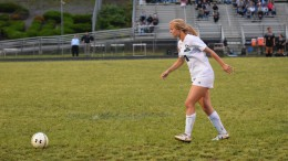 Rachel Golden rushes to the ball during a 2016 home game. As the captain of the Varsity Women's Soccer team, Golden takes charge of her team on both a physical and mental level. (Photo used by permission of Emma Sheppard Photography)