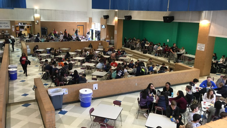 Similar to the cafeteria scenes in Mean Girls, the Leesville cafeteria is split up into different groups of high schoolers. The unwritten rules of lunchroom include only sophomores sit on the stage, freshman sit in the pit, and anyone else fills into any empty tables they can find. (Photo Courtesy of Cayley Kennedy)