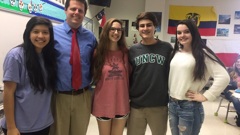 Sr. Ross teaches AP Spanish Language & Culture during two class periods both first and second semester. Jocelyn Torres, senior, Morgan Bateman, senior, Adam Bateman, senior, Megan Farrell, junior, and all of Ross's students have built close relationships with him over the course of the class.