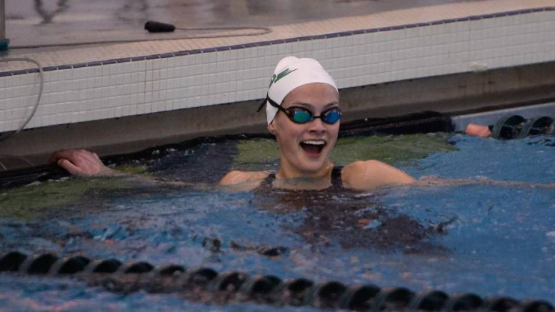 Grace Countie, junior, celebrates after winning the 50m free at the 2016 NCHSAA 4A Swimming Championship. Countie has won three individual state swimming titles and holds the state record in the 50m freestyle. (Photo used by permission of the News and Observer)