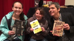 Students Sarah Stoflet, junior, and Erin Darnell, sophomore, pose with visiting author Allan Wolf after hearing him speak. They had the opportunity to listen to his performance as well as interview him about his life and career. (Photo used by permission of Allan Wolf)