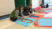 "Erika Nelson, a junior, and Hayden Stephens, a sophomore, paint a banner stating ""91st State Convention"" to decorate the school. They are members of Leesville's Executive Council that have worked to prepare for the convention.  (Photo Courtesy of Erin Darnell)"