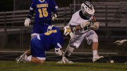 Cole Jankowsky, junior, chases a loose ball after winning a faceoff. The Pride defeated the Garner Trojans 18-1 and improved to 1-1 on the season.  (Photo used by permission of Sarah Myers)