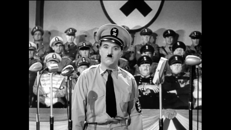 Fed up with the American system, in 1940, Charlie Chaplin started his own nation named Tomainia, and struck an alliance with nearby Bacteria. The above picture shows one of his stirring speeches as he stands before his nation's double-cross flag. (Screengrab courtesy of Turner Classic Movies)