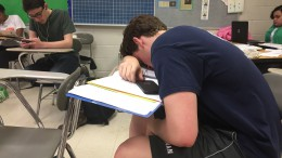 A senior rests after hours of what has likely been grueling work. Resting, also known as taking a break, is one of the tragic symptoms associated with Senioritis.