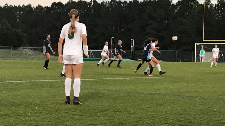 Avery Gardner prepares to head the ball to her teammate against Millbrook. The Pride suffered their first loss of the season Wednesday night. (Photo Courtesy of Tyler Stocum)