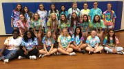 The yearbook staff gather to take a picture in their matching tie-dye's before the rush of students to pick up their books. Yearbook is a year-long, application based, class that is run by students with Joni Amerson as their staff advisor. (Photo used by permission of Joni Amerson)