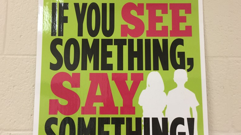 "A ""If you see something, say something!"" poster located outside student services. If you suspect anyone of suffering from child abuse, tell an adult immediately. (Photo Courtesy of Jonathan Spear)"