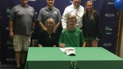 Caulfield poses with family members and coaches after officially signing to Catawba College. Caulfield also received an offer from Guilford College but decided Catawba was the best option. (Photo Courtesy of Jonathan Spear)