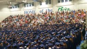The class of 2017 gathered in the gym for the senior assembly, decked out in their caps, gowns, and chords. The assembly illustrated their time spent in high school and celebrated their future. (Photo courtesy of Hannah Comeskey)