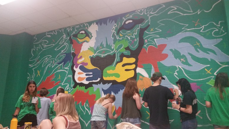 The AP art students work on the senior mural during their fourth period. The mural is the senior gift for the class of 2017. (Photo courtesy of Hannah Comeskey)